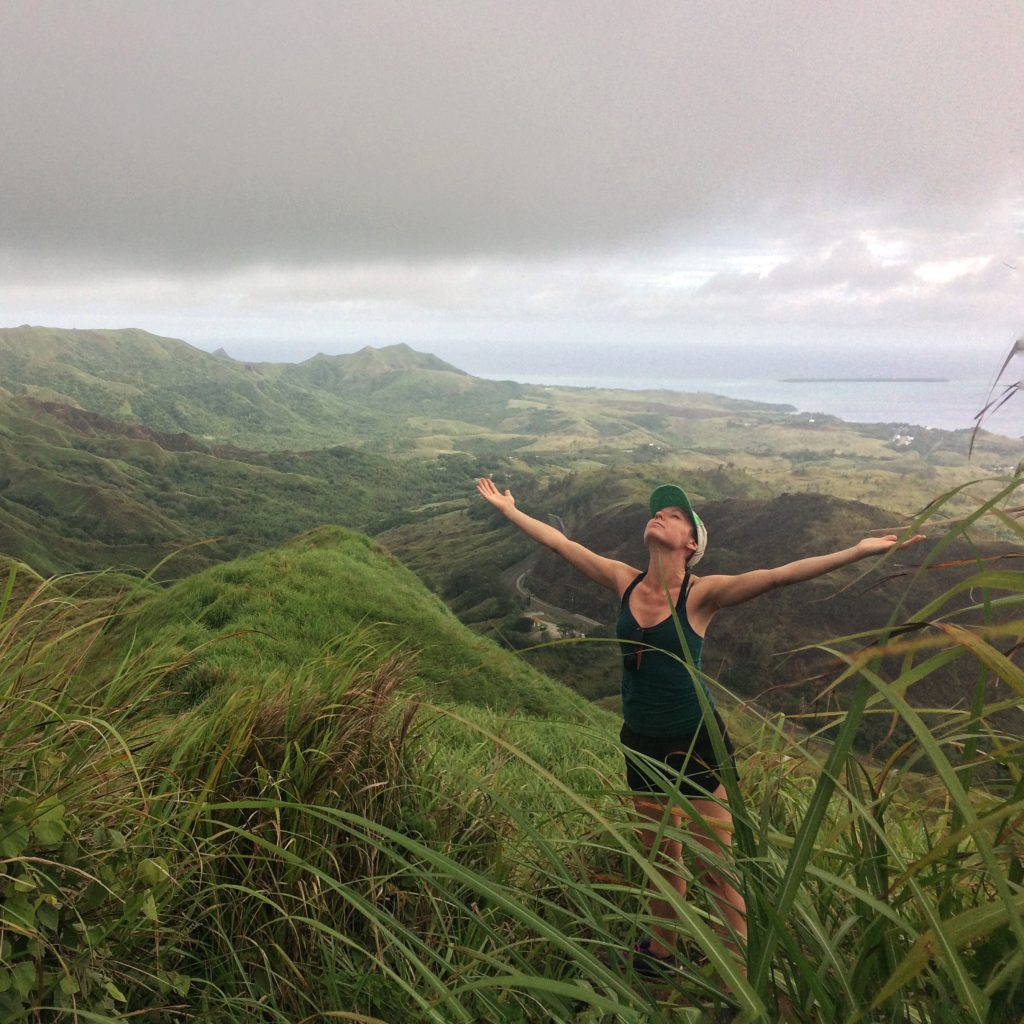 Travel writer Leandra Beabout stands in the rain on Mount Jumullong Manglo in the U.S. island territory of Guam